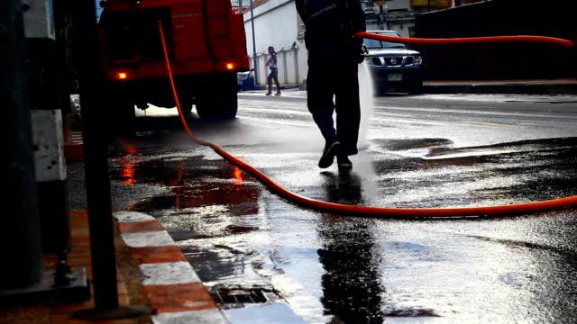 vídeos y material grabado en eventos de stock de limpiar street, tailandia - barrer