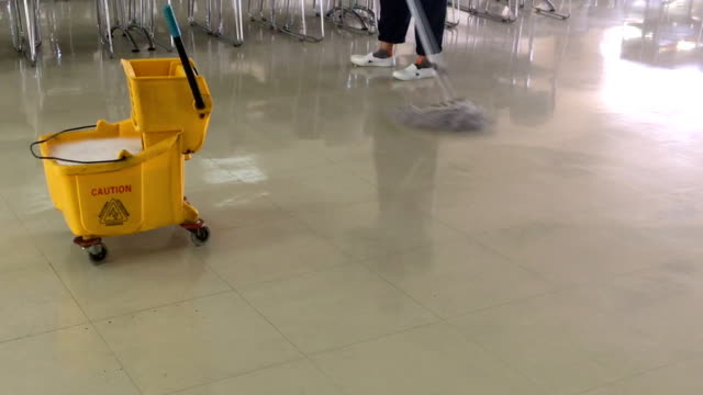 Clean the floor in canteen.