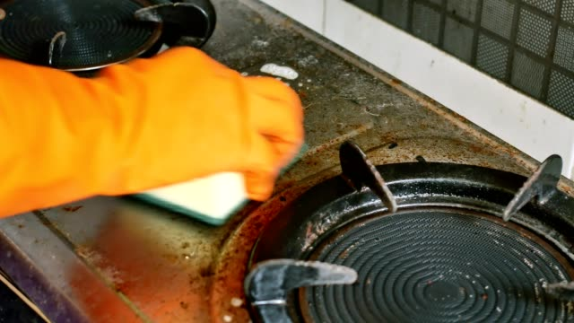 clean the gas stove with sponge. - housework stock videos & royalty-free footage