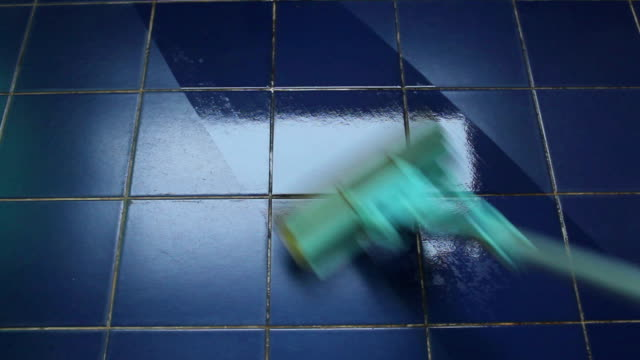 Clean the tiles with a sponge mop.