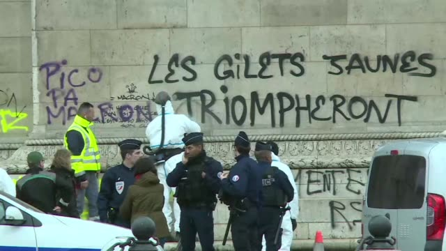 clean up is underway at the arc de triomphe in paris the day after clashes between police and yellow vest demonstrators left dozens of cars burned... - vandalism stock videos & royalty-free footage
