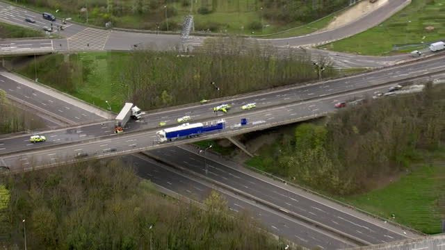 aerial shots of lorry smashed through the barrier of a bridge in kent, causing long delays around the m25 near dartford on 7rd april 2021 in london,... - emergencies and disasters stock videos & royalty-free footage