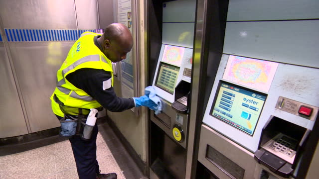 cleaner disinfecting ticket machine on london underground during coronavirus outbreak - cleaning stock videos & royalty-free footage