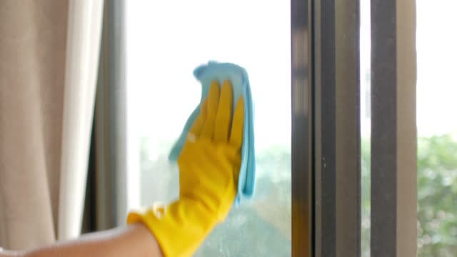 cleaner spraying on window glasses and wiping off by microfiber cloth , cleaning footage concept - cleaner stock videos and b-roll footage