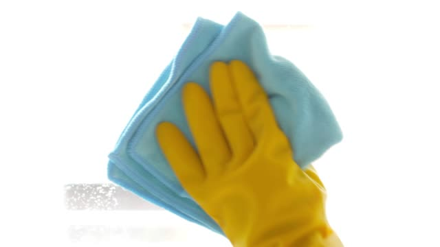 Cleaner spraying on window glasses and wiping off by Microfiber cloth , cleaning footage concept