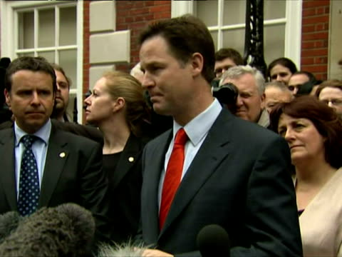 exterior shot nick clegg stands outside liberal democrat's headquarters surrounded by party members & addresses the gathered media regarding the... - british liberal democratic party stock videos & royalty-free footage