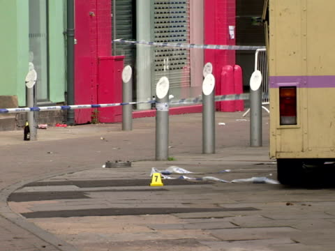 exterior shots custard factory nightclub with police cordon tape forensic markersthe police have launched a major inquiry after four people were shot... - gun crime stock videos & royalty-free footage