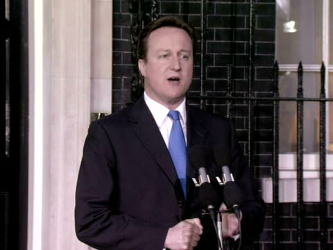 exterior shots david cameron stands at podium addresses the gathered media as prime minister announces his plans for the coalition government - david cameron politician stock videos & royalty-free footage