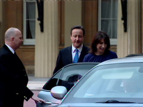 exterior shots new prime minister david cameron & his wife samantha leaving buckingham palace where the tory leader accepted the queen's request for... - premierminister stock-videos und b-roll-filmmaterial