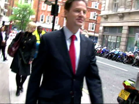 exterior shots nick clegg departs bbc building & walks down the street. - british liberal democratic party stock videos & royalty-free footage
