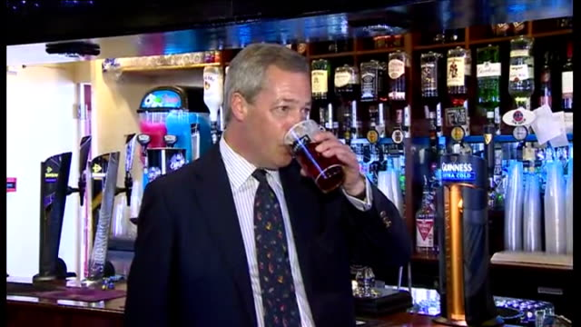 exterior shots niqgel farage ukip leader arriving in ramsgate interior shots nigel farage drinking beer ahead of meeting members of public interior... - elezioni generali video stock e b–roll