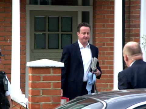 exterior shots Prime Minister David Cameron departs his home gets into car is driven off