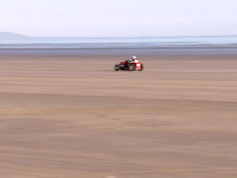 exterior shots project runningblade lawnmower speeding along beach on world record beating runthe world land speed record for a lawnmower has been... - world record stock videos and b-roll footage