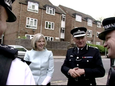 exterior shots theresa may mp, the new home secretary meets & chats with a group of police officers.theresa may, keen to get a grass roots... - may stock videos & royalty-free footage