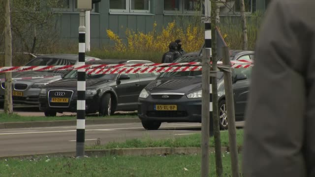 exterior views of police and forensic officers at the scene of a shooting on a tram including armed police and police searching tram for evidence on... - utrecht stock videos & royalty-free footage