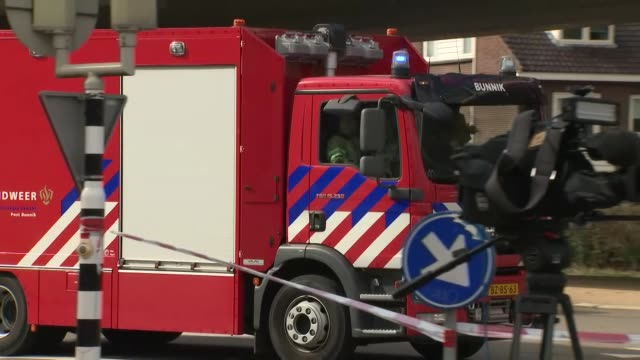 exterior views of police fire and rescue services at the scene of a shooting on a tram including a helicopter flying over the crime scene on 18 march... - utrecht stock videos & royalty-free footage