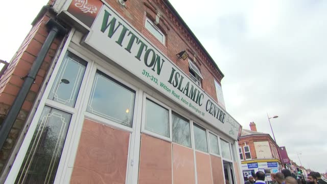exterior views of the damaged and vandalised witton islamic centre in aston including boarded up windows and man sweeping up broken glass from... - moschea video stock e b–roll