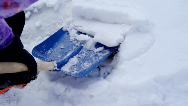 cleaning a snow with shovel-b roll - removing stock videos & royalty-free footage