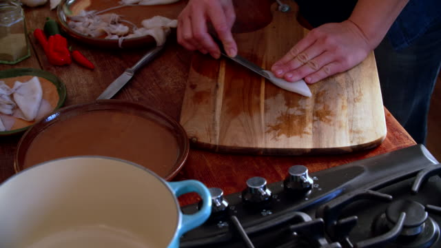 cleaning and cutting fresh squid on a wooden cutting board - cuttlefish stock videos and b-roll footage