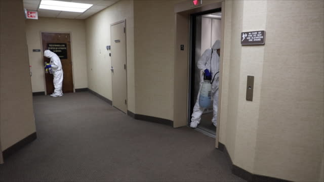 cleaning and disinfecting office - cleaner stock videos & royalty-free footage