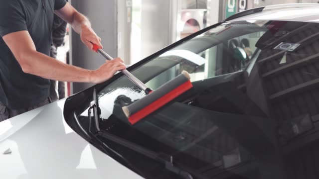 cleaning car windows - windshield stock videos & royalty-free footage
