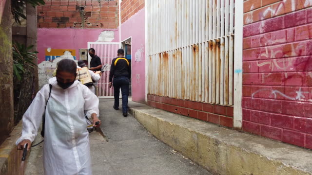 cleaning company workers disinfecting building walls during covid-19 pandemic in petare, caracas, venezuela, on thursday, september 3, 2020. - spray stock videos & royalty-free footage