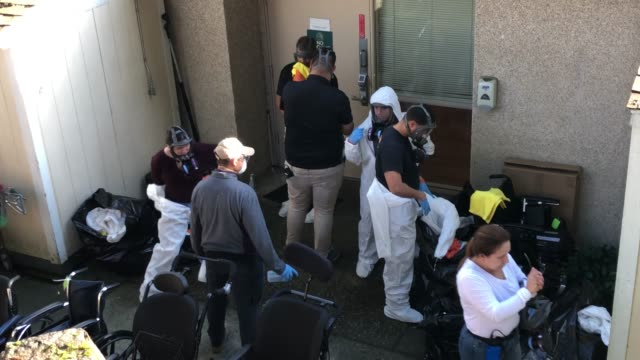cleaning crew disinfects and removes protective clothing after exiting the life care center on march 11, 2020 in kirkland, washington. most of the... - raw footage stock videos & royalty-free footage