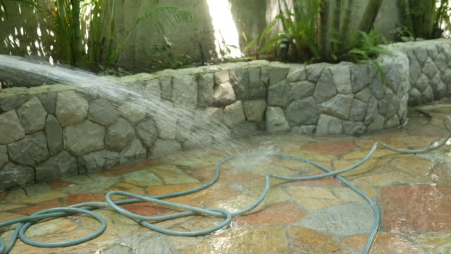 cleaning floor in spa garden - spray insulation stock videos & royalty-free footage