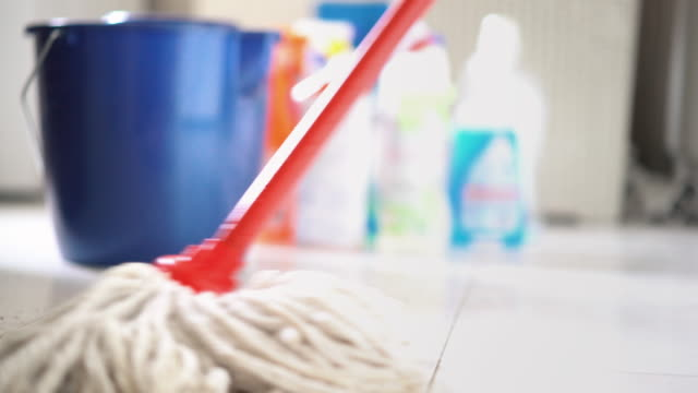 cleaning floors. - lavori di casa video stock e b–roll
