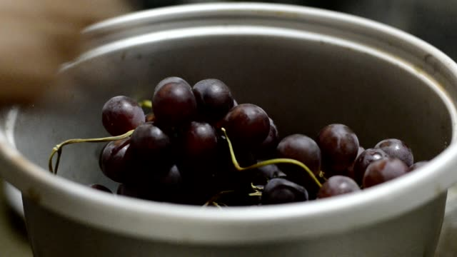 Cleaning grape in water