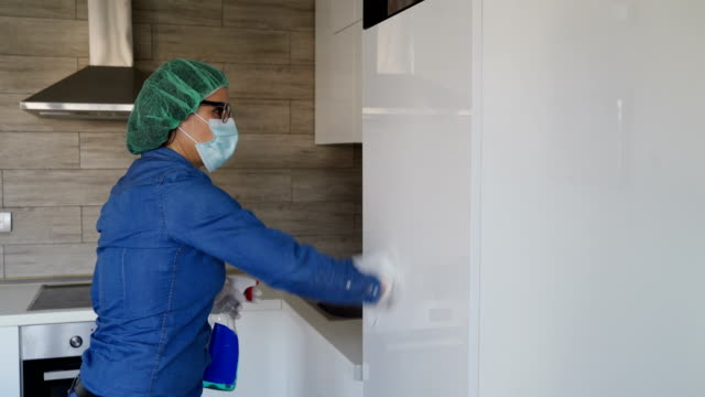 cleaning home in self isolation-prevention corona virus - prevention stock videos & royalty-free footage