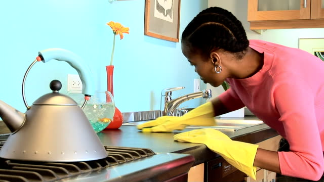 cleaning kitchen - washing up glove stock videos & royalty-free footage