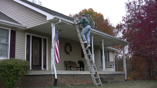 cleaning out the gutters - sidewalk gutter stock videos & royalty-free footage