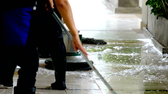 cleaning service team cleaning floor with scrubber machine and cleaning in process label - clean stock videos & royalty-free footage