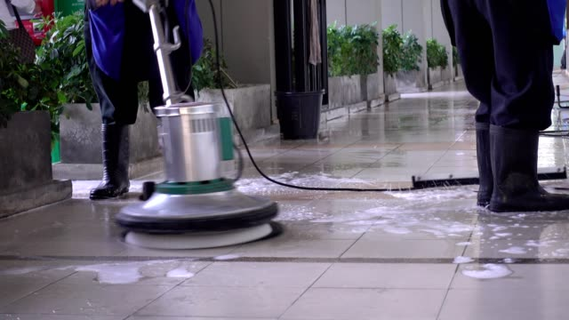 cleaning service team cleaning floor with scrubber machine and cleaning in process label - vacuum cleaner stock videos & royalty-free footage