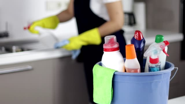 cleaning supplies in bucket, woman cleaning on background, - cleaning agent stock videos & royalty-free footage