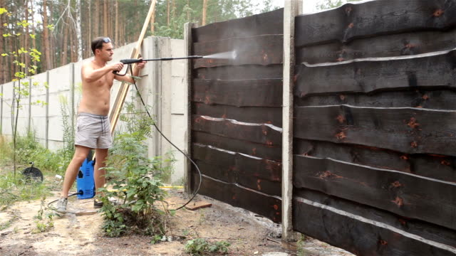 Cleaning the fence from dirt.