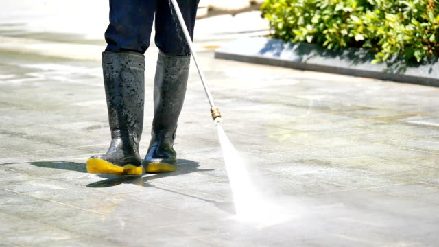 cleaning the floor by spaying water