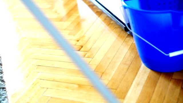 cleaning the floor with a mop. - wooden floor stock videos & royalty-free footage