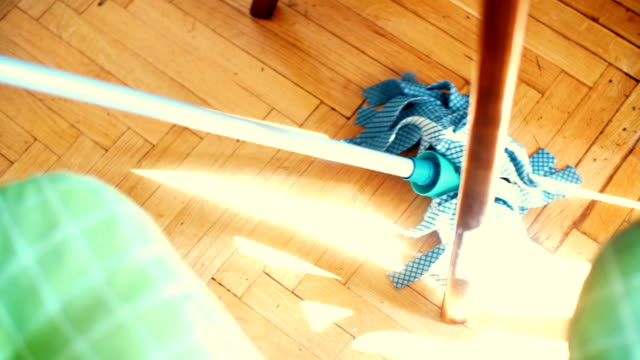 cleaning the floor with a mop. - table top shot stock videos & royalty-free footage