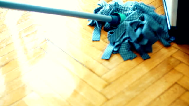 cleaning the floor with a mop. - slippery stock videos & royalty-free footage