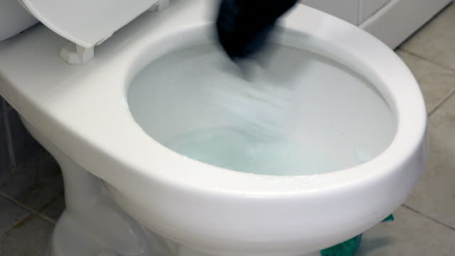 cleaning the house bathroom or washroom - schüssel stock-videos und b-roll-filmmaterial