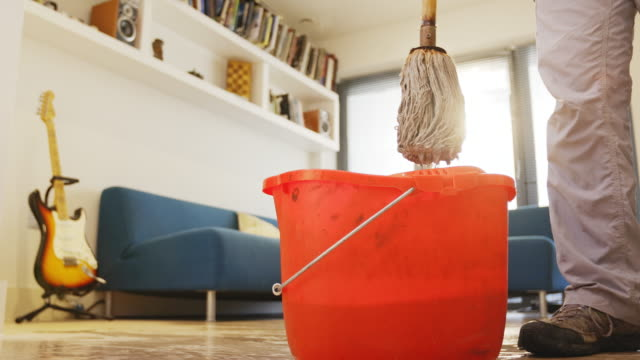cleaning the house - eimer stock-videos und b-roll-filmmaterial