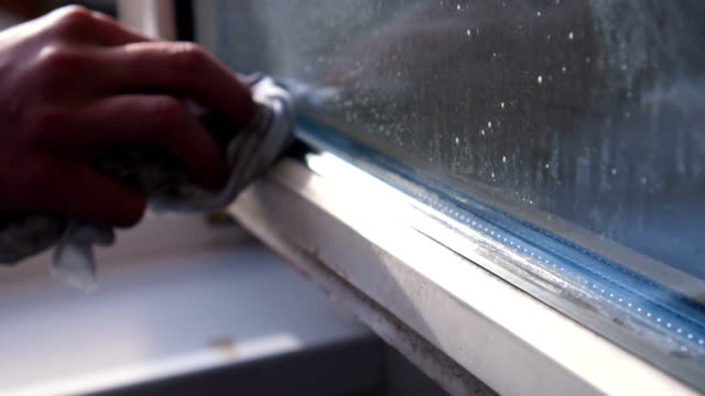cleaning window - spraying stock videos and b-roll footage