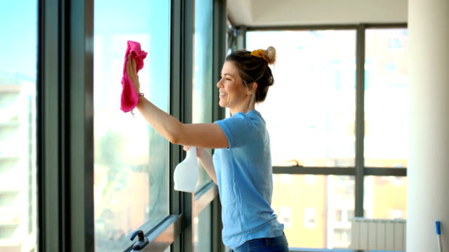 cleaning windows on a weekend. - window washer stock videos & royalty-free footage