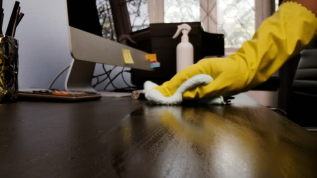 cleans the working desk with the wiping cloth,dolly macro shot. - desk stock videos & royalty-free footage
