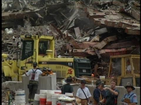 cleanup activities continue at ground zero, the new york site of the 9-11 terrorist attacks. - 2001 bildbanksvideor och videomaterial från bakom kulisserna