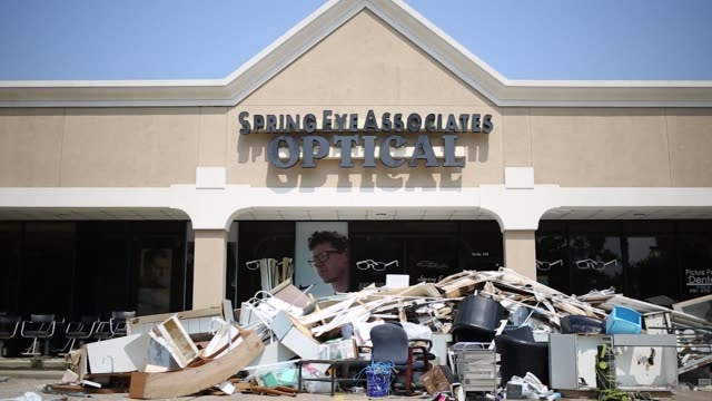Cleanup efforts following Hurricane Harvey are pictured outside of a Spring Eye Associates Optical Store in Houston Texas US on Wednesday Sept 6 2017...