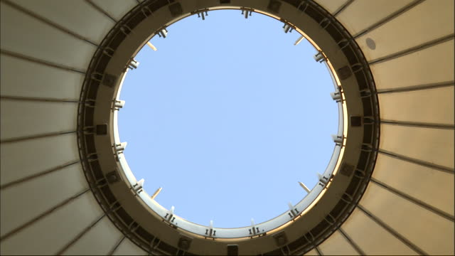 a clear blue sky shows through an opening in the roof of hajj terminal. - hajj stock-videos und b-roll-filmmaterial