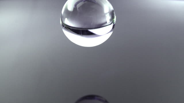 SM CU Clear glass sphere falling into water/ Auckland, New Zealand